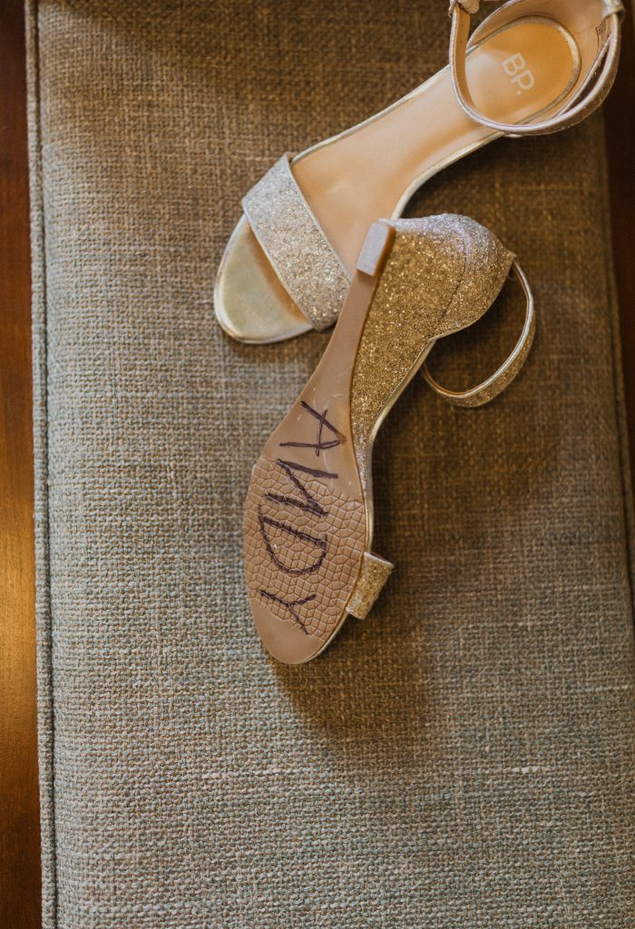 Writing on the bottom of bride's shoe