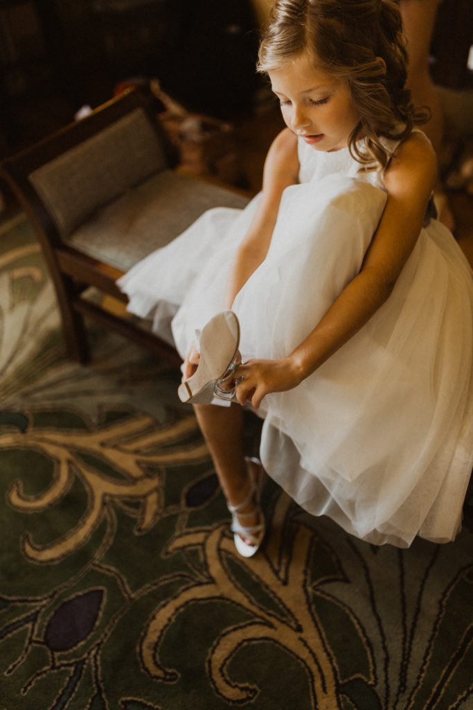 Flower girl putting her shoes on