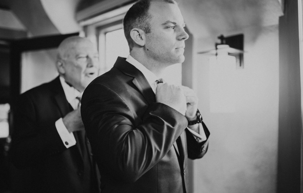Groom getting ready before ceremony in Colorado