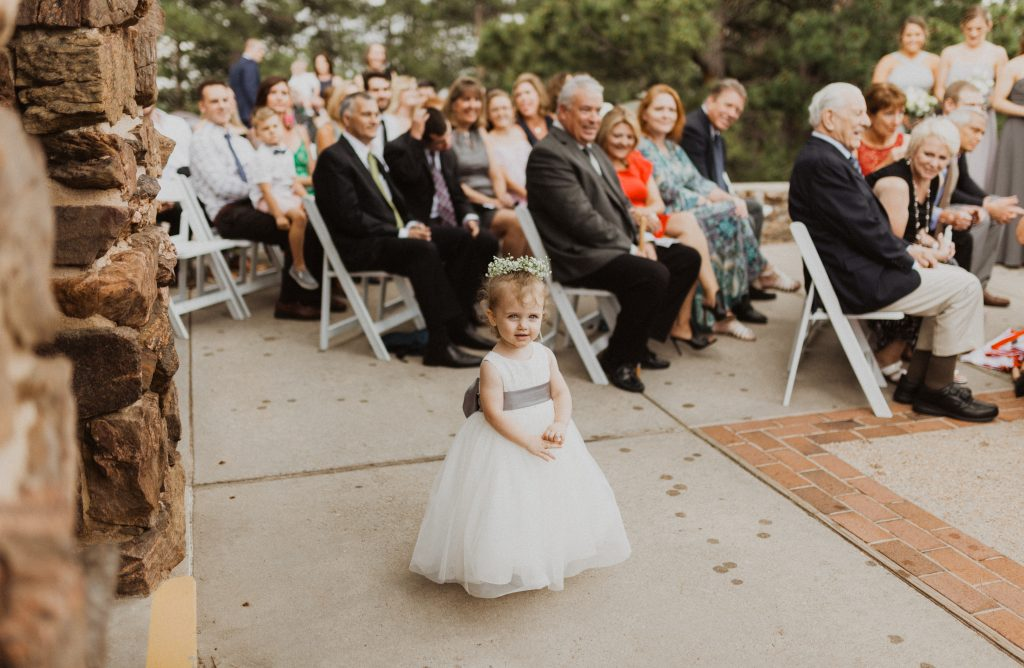 Flower girl walking down the isle at wedding