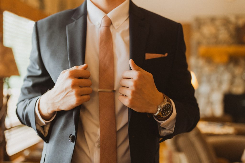 Groom in tie with clip before wedding in Colorado
