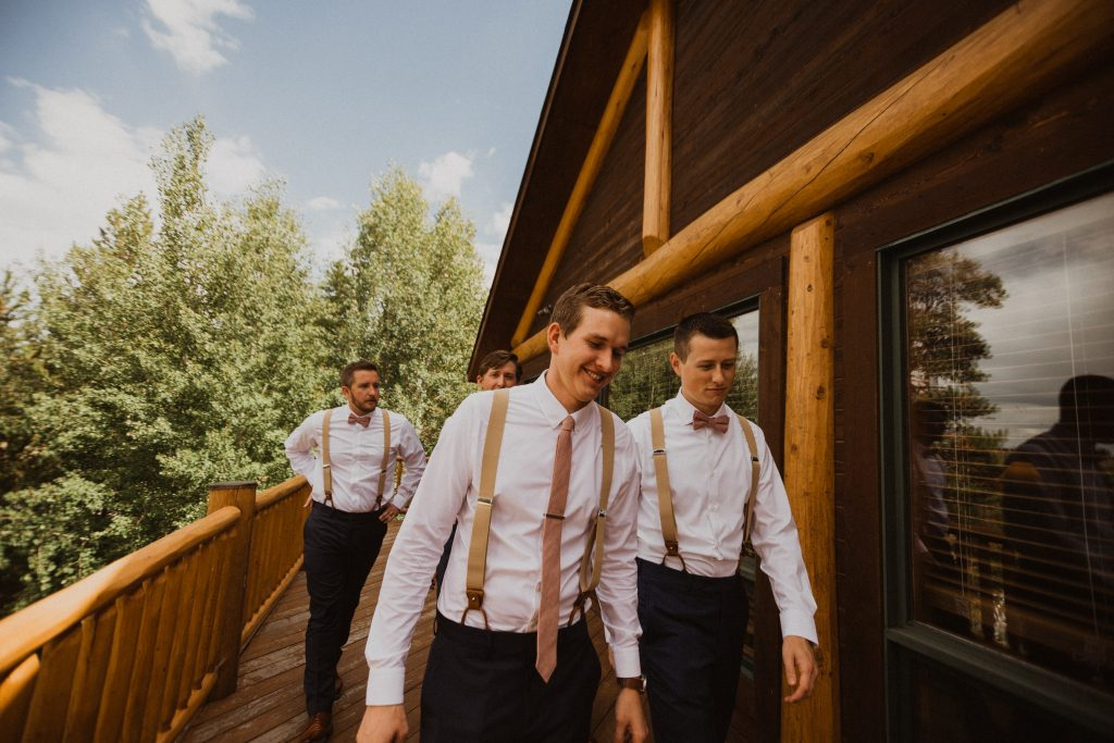 Groomsmen walking before wedding in Granby, Colorado