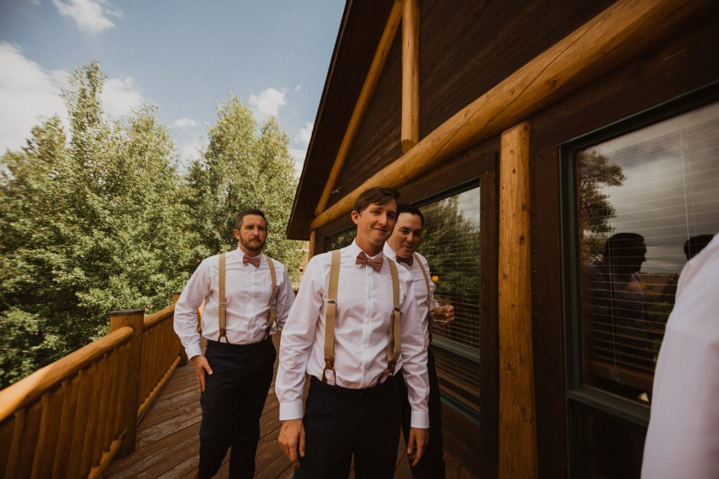 Groomsmen walking before wedding at Strawberry Creek ranch, Colorado
