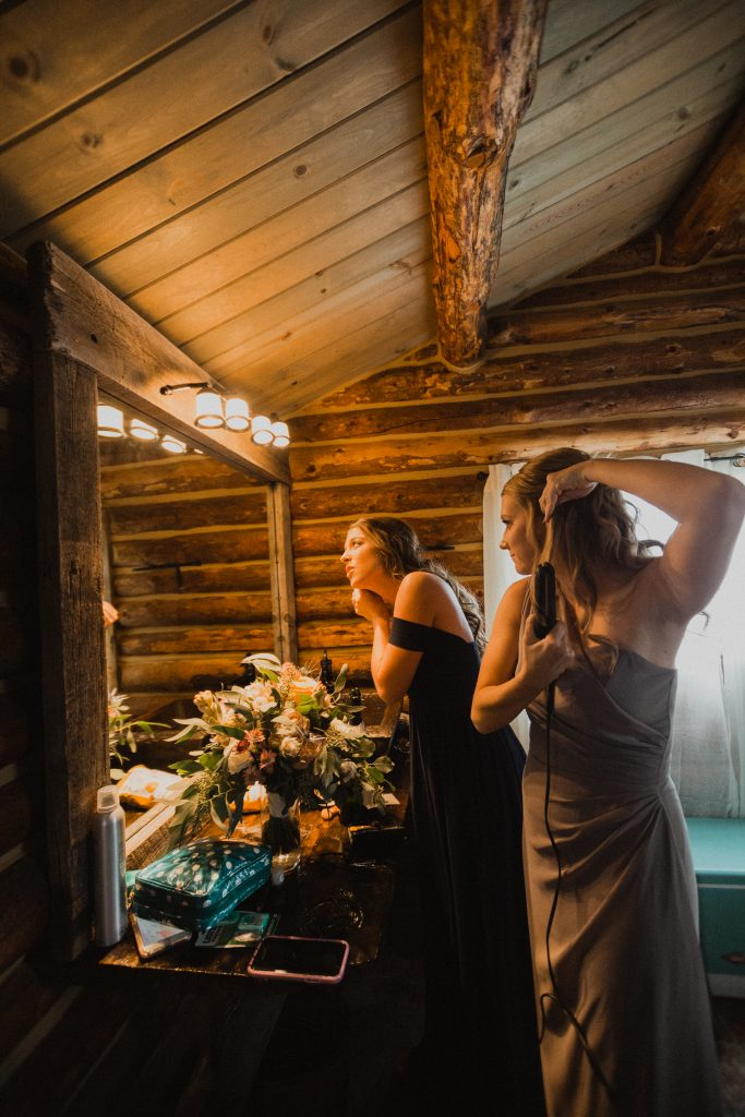 Bridesmaids getting ready for wedding in Granby, Colorado