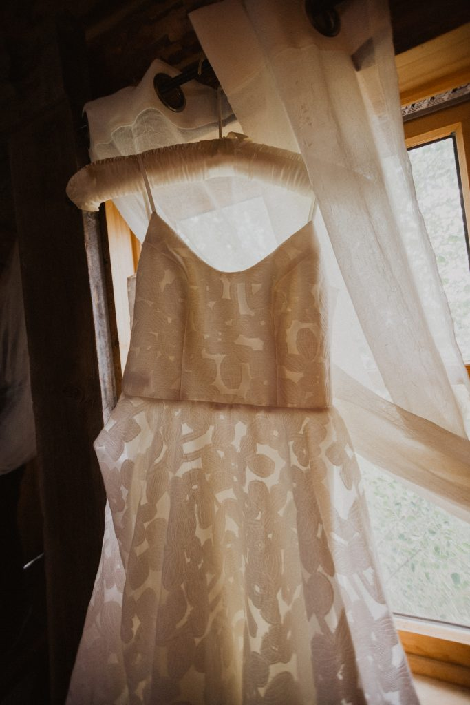 Wedding dress hanging before wedding in the mountains of Colorado