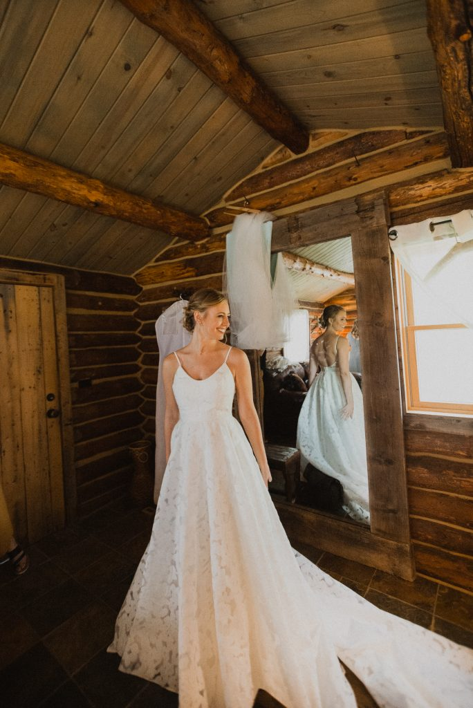 Beautiful bride in unique dress at Granby, Colorado mountain wedding