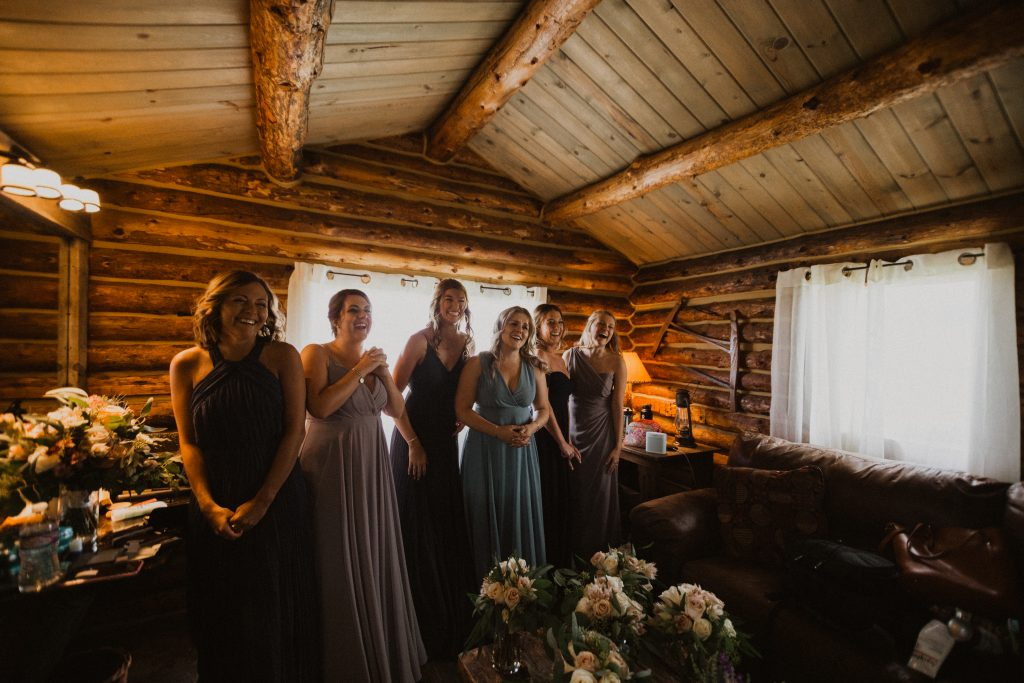 Bridesmaids cheer for Bride during first look