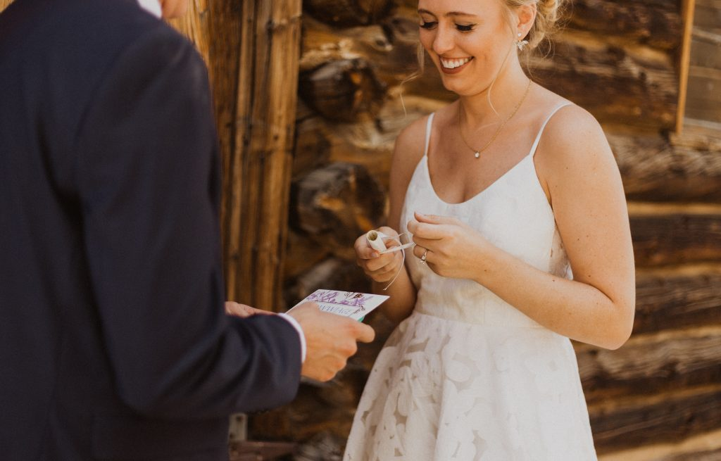 Bride and groom exchanging vows at wedding in Colorado